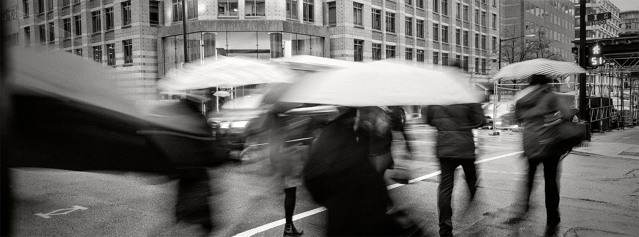 Umbrellas in Motion, 18th and I Street NW by Britt Leckman