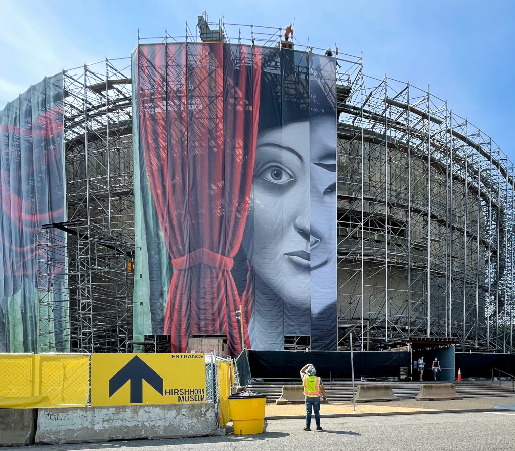 Installation of Draw the Curtain, an artwork by Nicolas Party, spanning the exterior of the Hirshhorn Museum